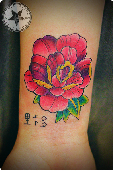 rose tattoo by mania tattoo blackpool